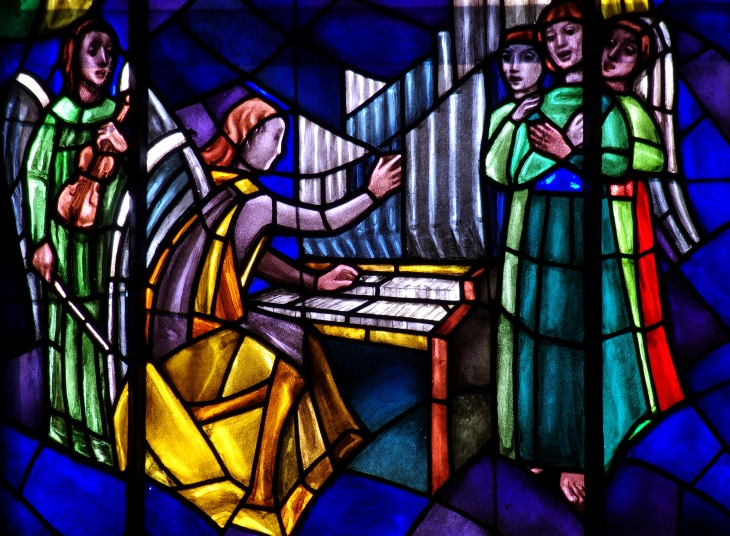 Angels: singing and making music in stained glass