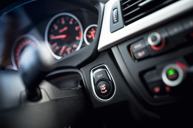 close-up of car start and stop button